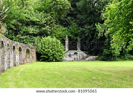 garden with stone walls from a abbey in france