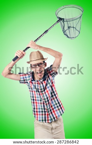 Gardener with net against the gradient - stock photo