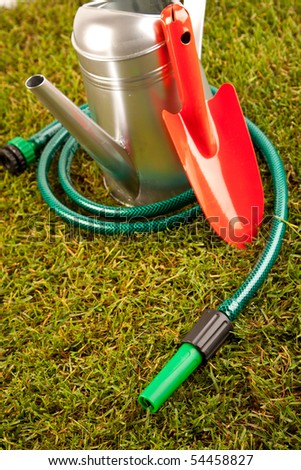 Gardening equipment on green grass