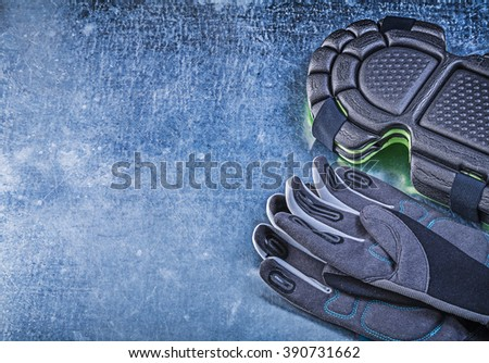 Gardening safety gloves knee pads on metallic background agriculture concept. - stock photo