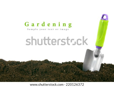 Gardening. The garden tool on the earth. - stock photo