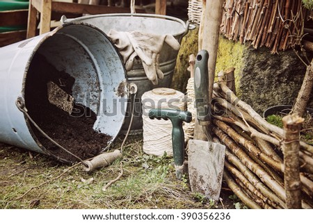 Gardening Tools and Equipment with Bucket,Trees and Garden Wood Fence