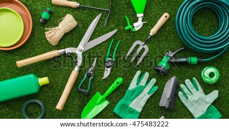 Gardening Tools And Utensils On A Lush Green Meadow, Top View, Garden  Manteinance,