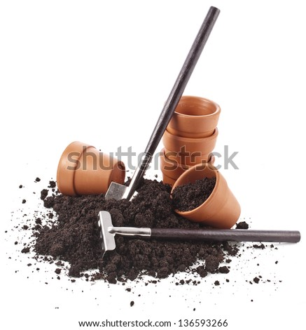 gardening tools, ceramic pot in soil heap isolated on a white background - stock photo