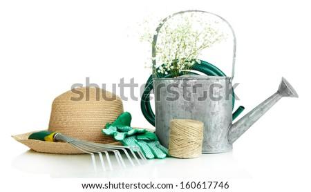 Gardening tools isolated on white - stock photo