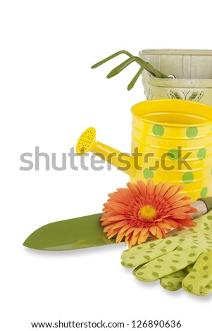gardening tools kit including trowel, cultivator, watering can, gloves, plant markers and pot over white background with copy space for your text - stock photo