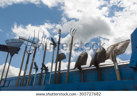 Gardening tools on a background of clouds