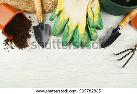 stock-photo-gardening-tools-on-old-white