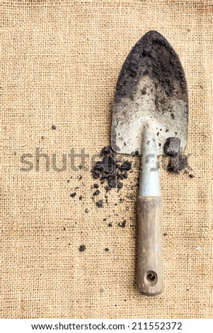 Gardening tools, soil on sack texture. Garden concept background with free text space. - stock photo