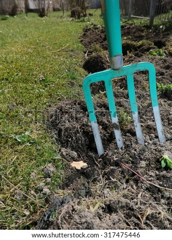 Gardening with a dung fork - stock photo
