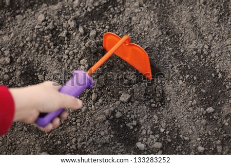 gardening with orange chopper - stock photo