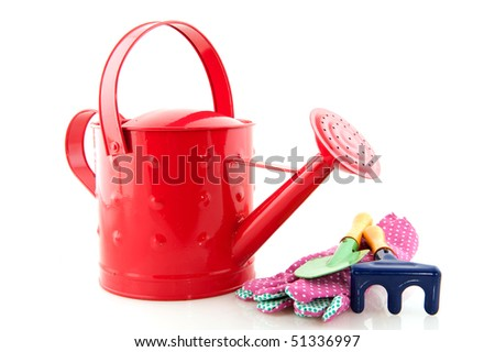 Gardening with watering can and work tools