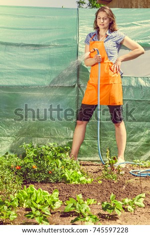 Gardening Woman Orange Apron Holds Sprinkler Stock Photo (Royalty ...