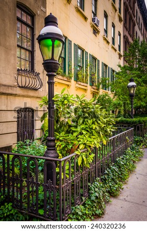 Gardens and townhouses along 23rd Street in Chelsea, Manhattan, New York.