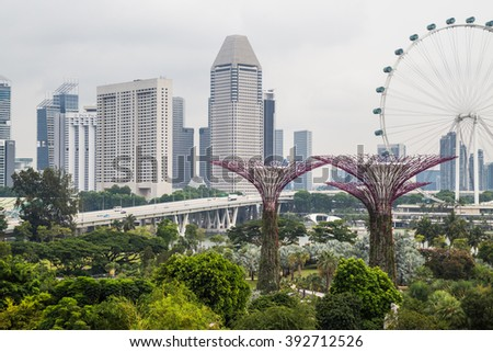 GARDENS BY THE BAY, SINGAPORE - JULY 8, 2015 : View of Suntec City over the Gardens by the Bay - stock photo