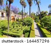 Gardens in Reales Alcazares in Seville - residence developed from a former Moorish Palace in Andalusia, Spain - stock photo