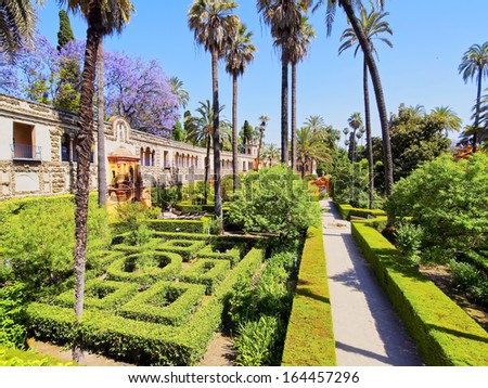 Gardens in Reales Alcazares in Seville - residence developed from a former Moorish Palace in Andalusia, Spain