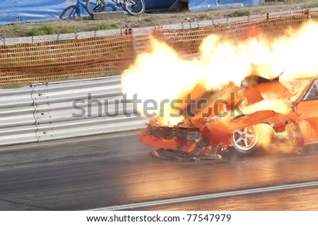 GARDERMOEN RACEWAY, NORWAY - MAY 14: Race car explodes into flames during a drag race on May 14,2011 at Gardermoen Raceway, Norway. The car disintegrates in a ball of fire. - stock photo