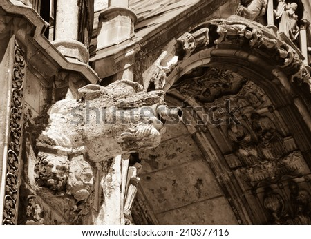 Gargoyle downspout. Architectural detail of  the cathedral in Chartres (France). Aged photo. Sepia - stock photo