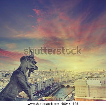 Gargoyle of Notre Dame at sunset, Paris, France - stock photo