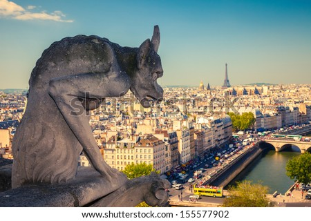 Gargoyle on Notre Dame Cathedral, Paris, France - stock photo