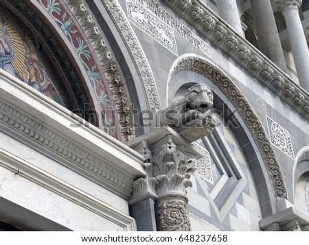 Gargoyle on Pisa Cathedral facade Italy