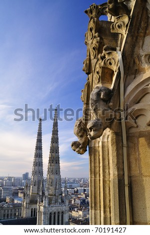 Gargoyles at the top of Pey-Berland tower, Cathedral Saint Andr�©, Bordeaux, France - stock photo