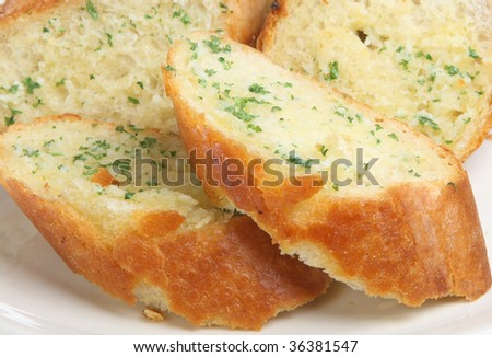Garlic and herb baguette - stock photo