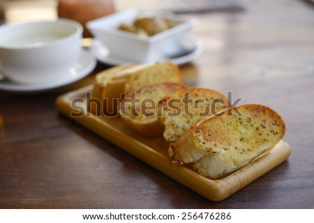Garlic and herb bread. - stock photo