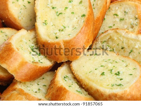 Garlic and herb bread baguette - stock photo