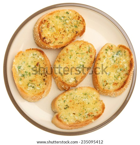 Garlic and herb bread on white background. - stock photo