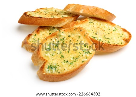 Garlic and herb bread slices on white background. - stock photo