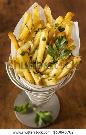 Garlic and Parsley French Fries with Ketchup - stock photo