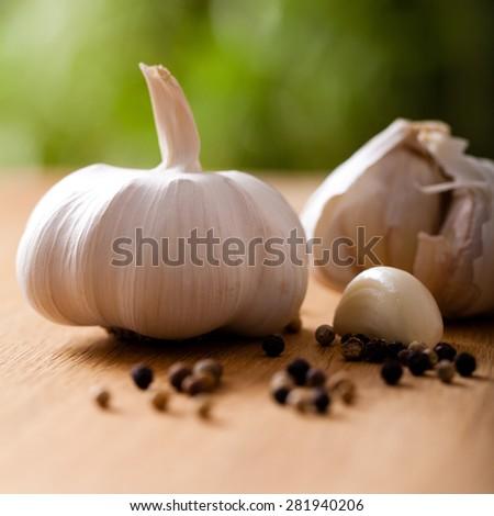 garlic and peppercorns - stock photo