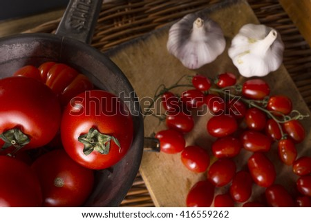 Garlic and tomatoes, basic ingredients for a tasty sauce - stock photo