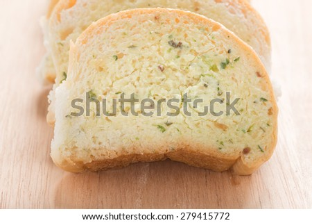 garlic bread and bacon on wooden board - stock photo
