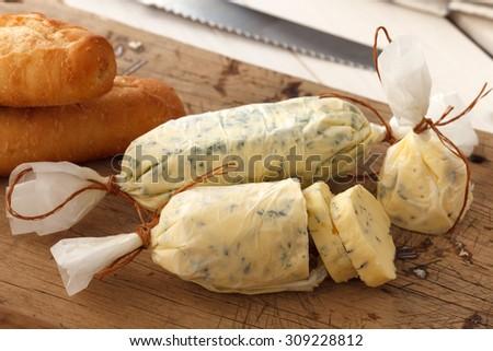 garlic bread compound butter herb baguette thyme rosemary coriander oregano fresh chopped homemade italian food snack tasty - stock photo