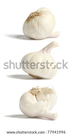 Garlic bulbs in three positions, isolated on white - stock photo