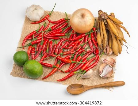 Garlic, chilli, ginger, onion, lemon, put on sackcloth on a white background. - stock photo