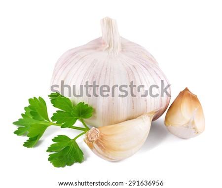 garlic decorated parsley leaves on white background - stock photo