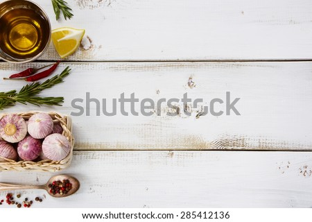Garlic, herbs and spices selection on white wooden background withs space for text. Cooking, food or health concept. - stock photo