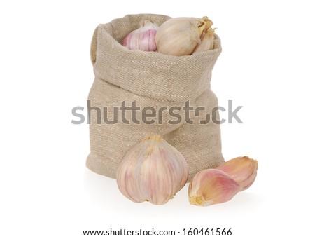 Garlic in bag on white background  - stock photo