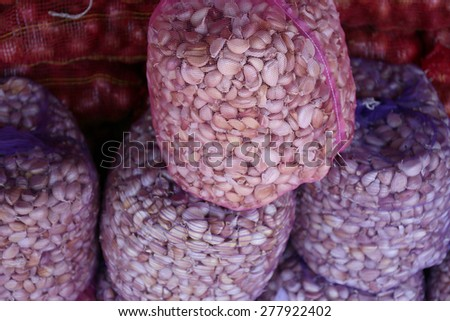 garlic in sack at market - stock photo