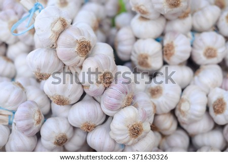 Garlic in sacks at the market or shop. Business trade - stock photo