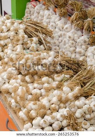 garlic on market stand - stock photo