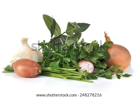 garlic,onions and shallots with herbs on white background - stock photo