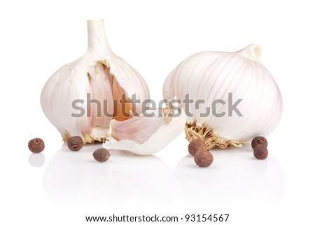 Garlic, pieces and Allspice Isolated on white background - stock photo