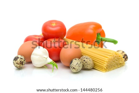 garlic, quail and chicken eggs, ripe tomatoes, pasta and sweet peppers on a white background. horizontal photo.