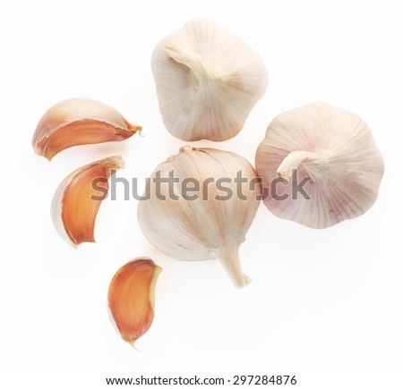 Garlic top view on white background. - stock photo