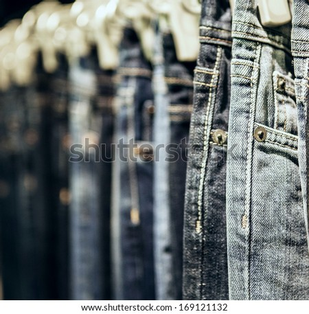 Garment rack with classic Jeans close up shot - stock photo